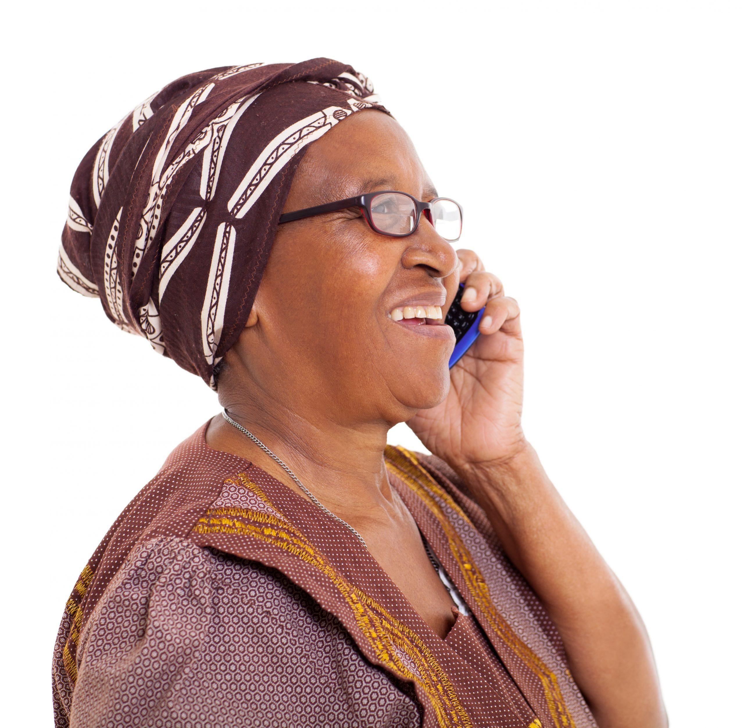 elderly african woman talking on smart phone